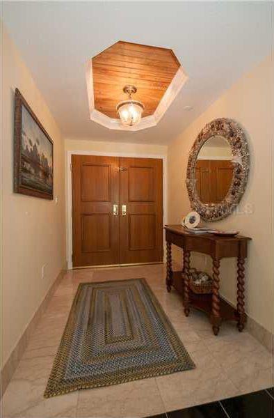 Traditional Entryway with Standard height, travertine tile floors, French doors, flush light, stone tile floors