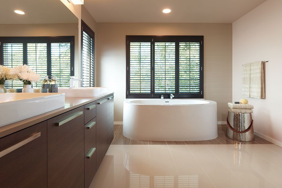Traditional Master Bathroom with can lights, Freestanding, Bathtub, Standard height, Double sink, Vessel sink, Casement