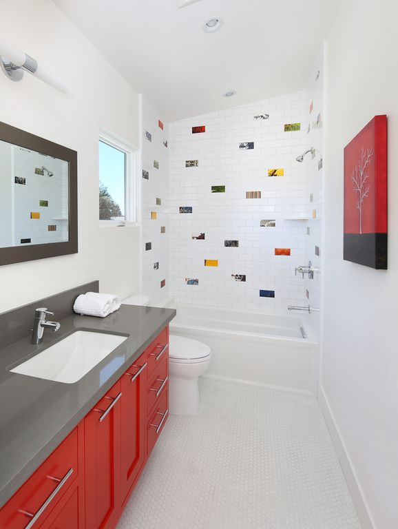 Contemporary Kids Bathroom with Flat panel cabinets, Shower, Kids bathroom, Standard height, Wall Tiles, partial backsplash