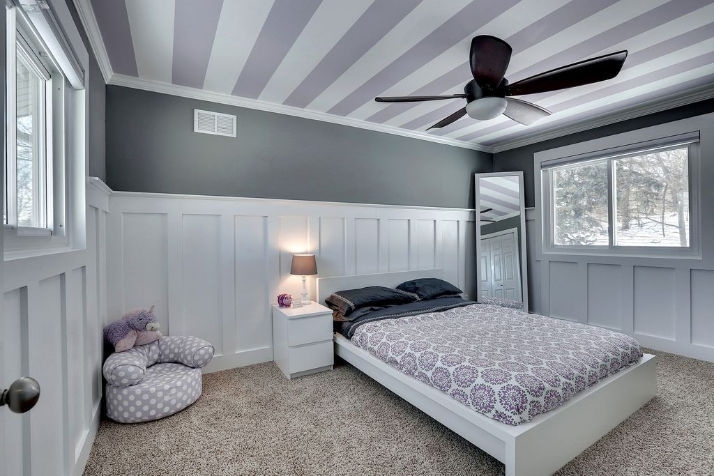 contemporary kids bedroom with crown molding wainscoting interior