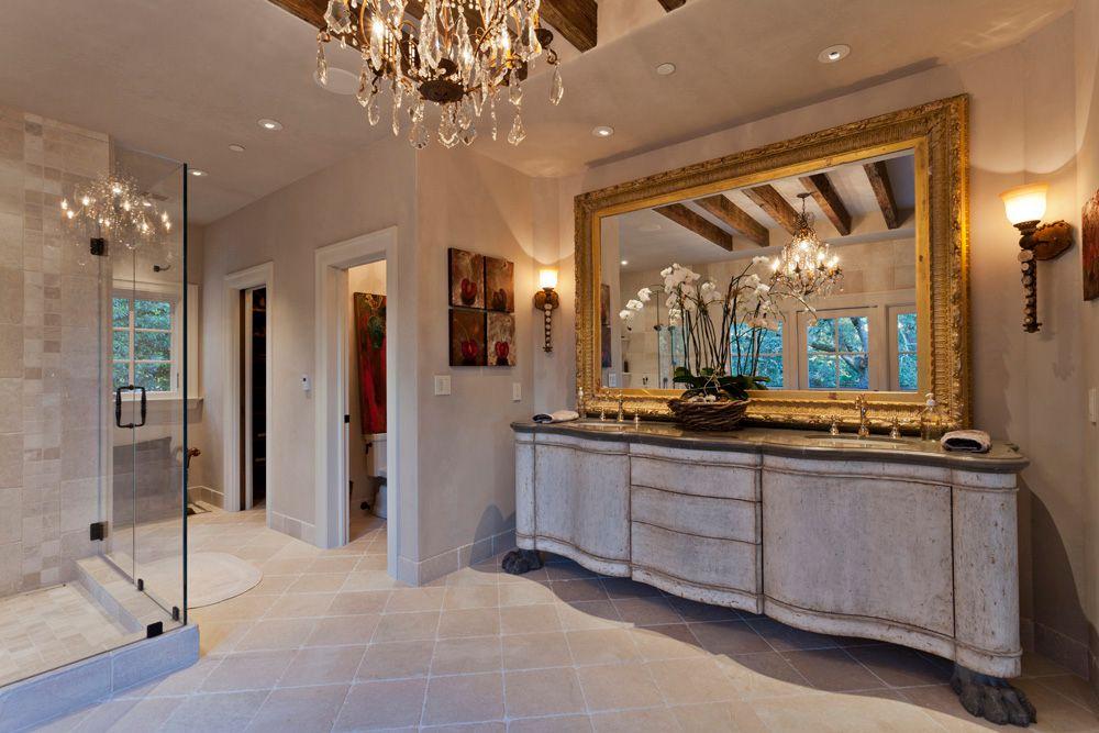 Traditional Master Bathroom with Soapstone counters, Undermount sink, frameless showerdoor, Chandelier, Standard height