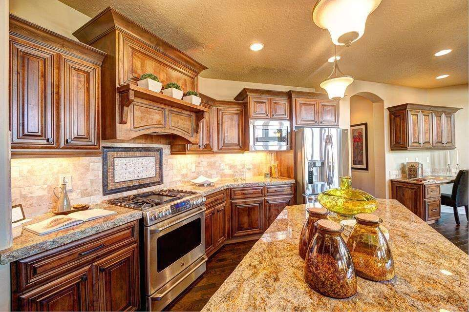 Traditional Kitchen with can lights, Pendant light, Standard height, Hardwood floors, Inset cabinets, Kitchen island