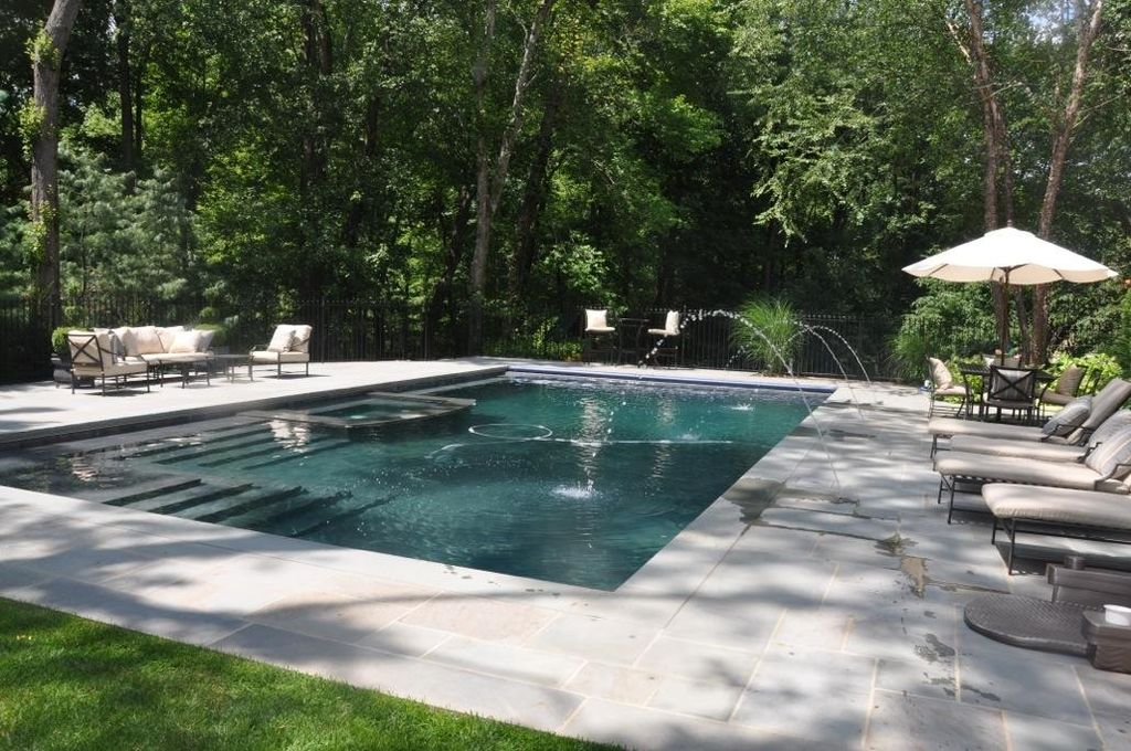 Traditional Swimming Pool with exterior stone floors, Pool with hot tub, Raised beds, Fence