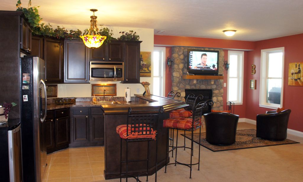 Traditional Great Room with Paint, flush light, stone fireplace, Standard height, stone tile floors, Scroll back bar stool