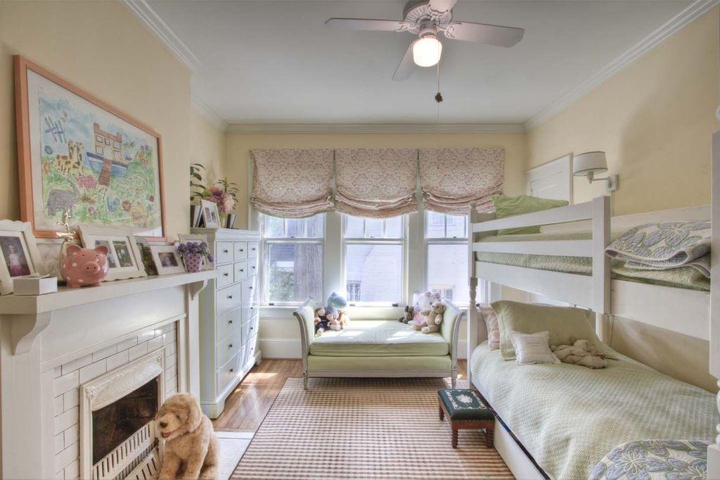Cottage Kids Bedroom with Ceiling fan, Bunk beds, Standard height, Fireplace, flush light, Crown molding, double-hung window