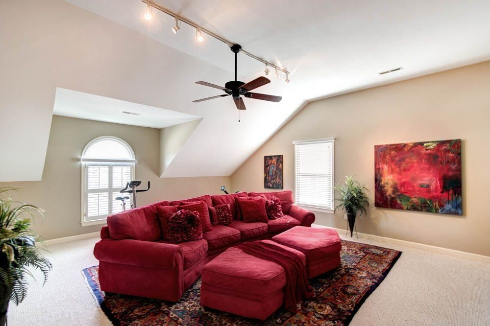 Traditional Living Room with Carpet, Standard height, Arched window, Ceiling fan, double-hung window, flush light