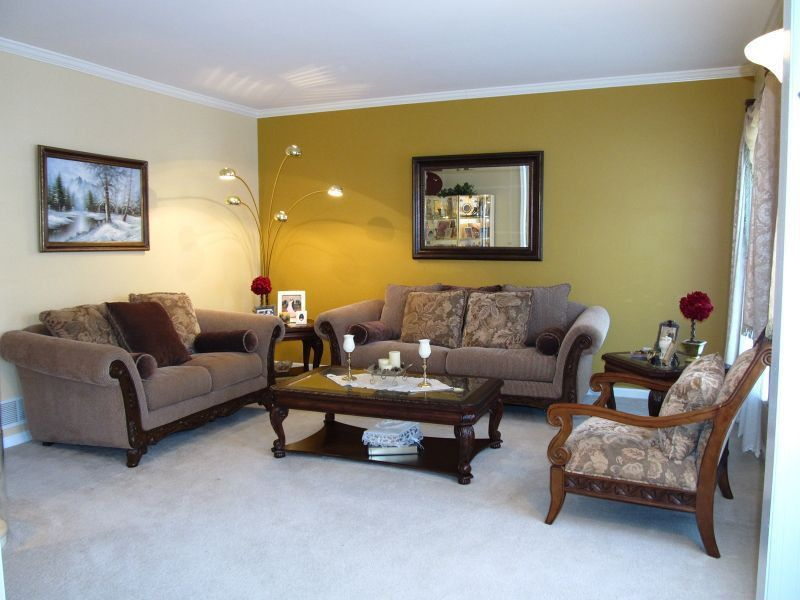 Eclectic Living Room with Standard height, Crown molding, Carpet