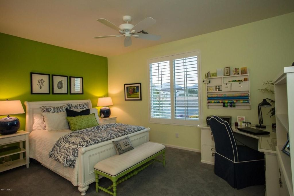 Cottage Master Bedroom with Standard height, Ceiling fan, Carpet, Casement, Built-in bookshelf
