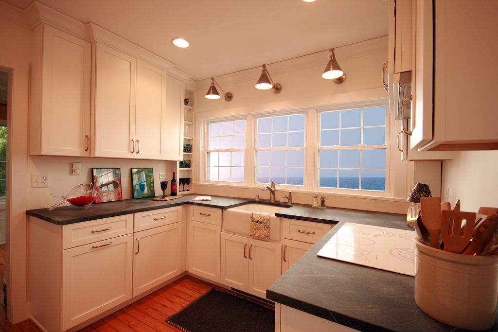 Modern Kitchen with Standard height, Flat panel cabinets, U-shaped, Soapstone counters, Crown molding, can lights
