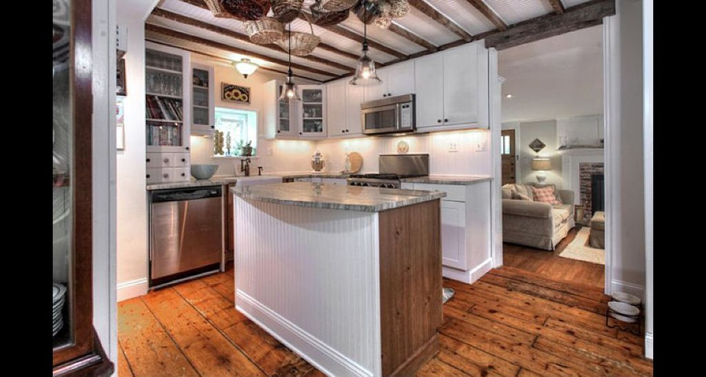 Eclectic Kitchen with Complex granite counters, built-in microwave, Glass panel, dishwasher, flush light, L-shaped, Flush