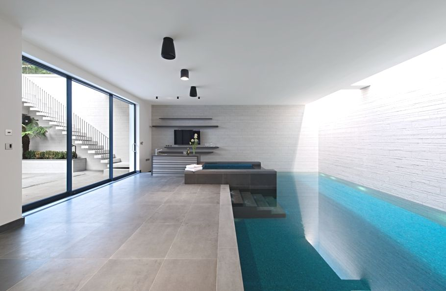 Contemporary Swimming Pool with exterior concrete tile floors, sliding glass door, Indoor pool, exterior tile floors