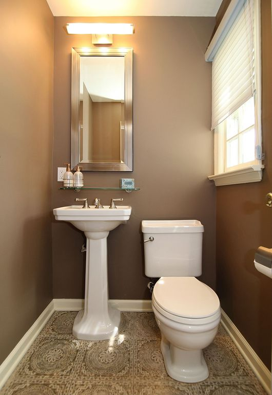 Traditional Powder Room with wall-mounted above mirror bathroom light, picture window, Powder room, Mexican tile