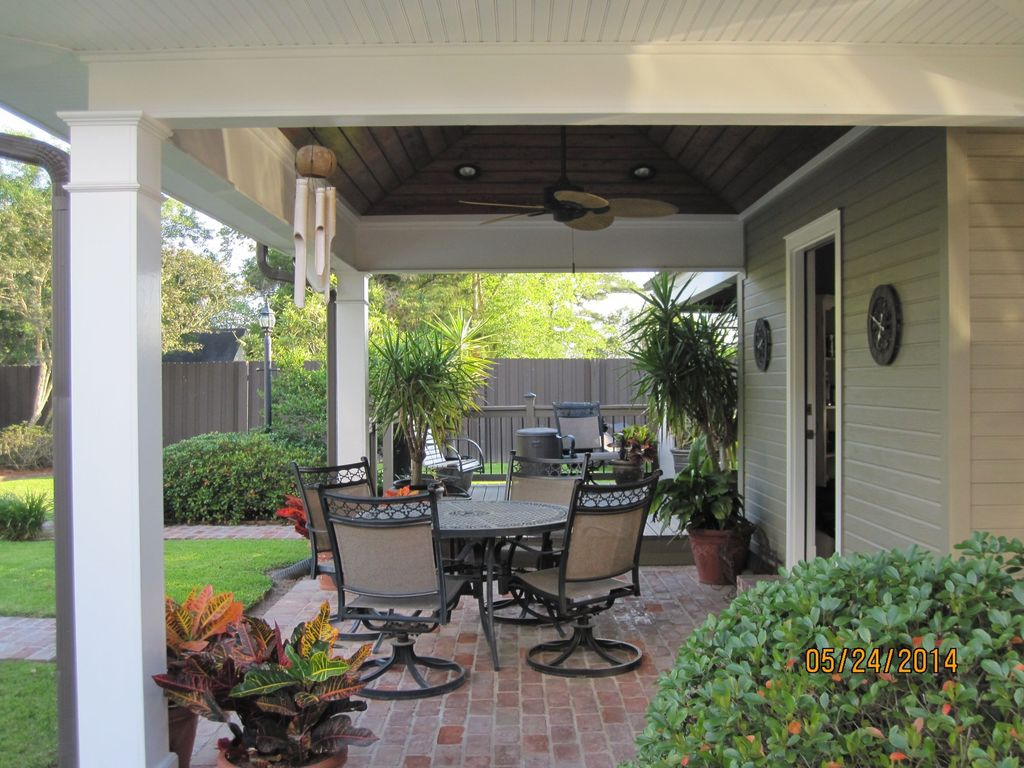 Traditional Porch with Fence, Screened porch, Pathway, exterior stone floors