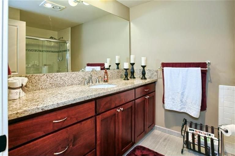 Craftsman 3/4 Bathroom with Simple Granite, Simple granite counters, three quarter bath, Flat panel cabinets, full backsplash