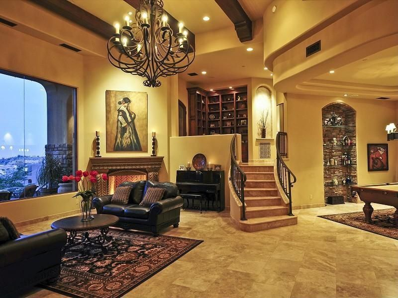Traditional Living Room with specialty window, Standard height, other fireplace, Exposed beam, Fireplace, can lights