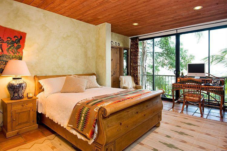 Eclectic Guest Bedroom with sliding glass door, Standard height, can lights, terracotta tile floors