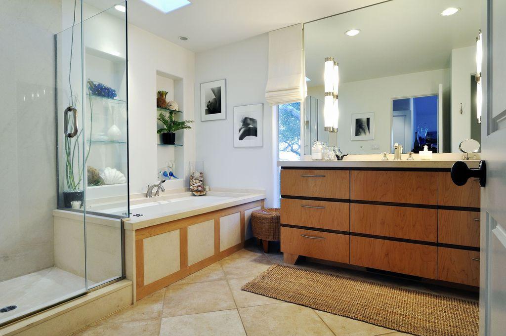 Modern Full Bathroom with Anji mountain jute andes area rug, Skylight, Undermount sink, specialty door, frameless showerdoor