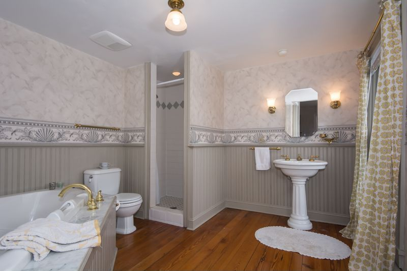 Traditional Master Bathroom with Standard height, Wall sconce, Shower, flush light, can lights, Hardwood floors, Wainscotting