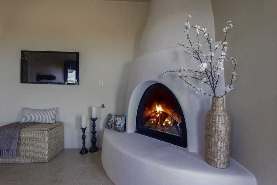 Eclectic Master Bedroom with Cement fireplace, Lifesize Woven Hyacinth Vase, Pottery Barn Turned Wood Pillar Holder - Medium