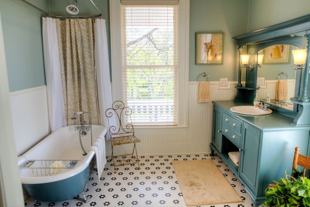 Cottage Full Bathroom with Flat panel cabinets, Metro Hex Matte White with Flowers Porcelain Floor Tile, Bathtub, Shower
