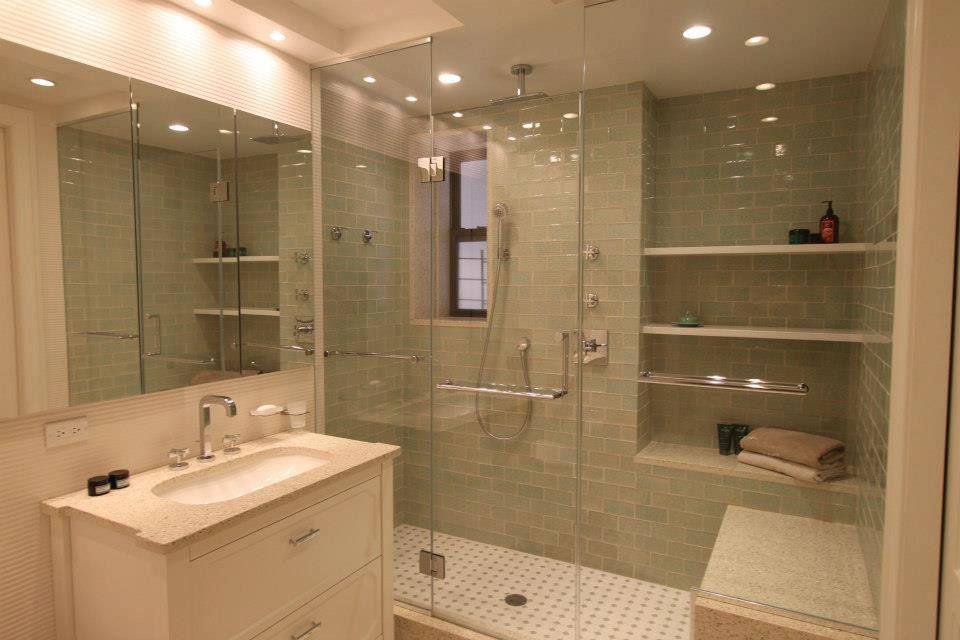Cottage Master Bathroom with Undermount sink, Flat panel cabinets, Rain shower, frameless showerdoor, penny tile floors