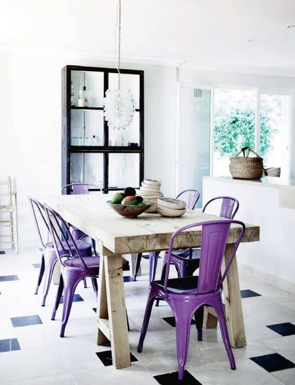 Eclectic Dining Room with Concrete tile , Chandelier, Crown molding, French doors, Standard height