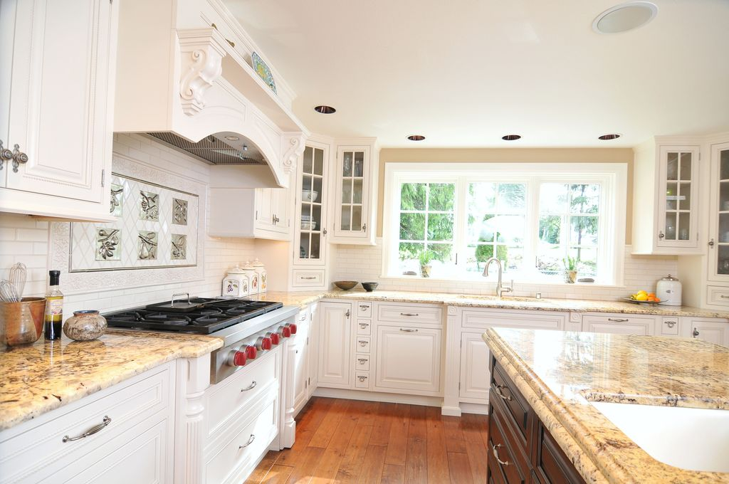 Traditional Kitchen with full backsplash, Crown molding, Complex granite counters, Casement, Wall Hood, L-shaped, Subway Tile