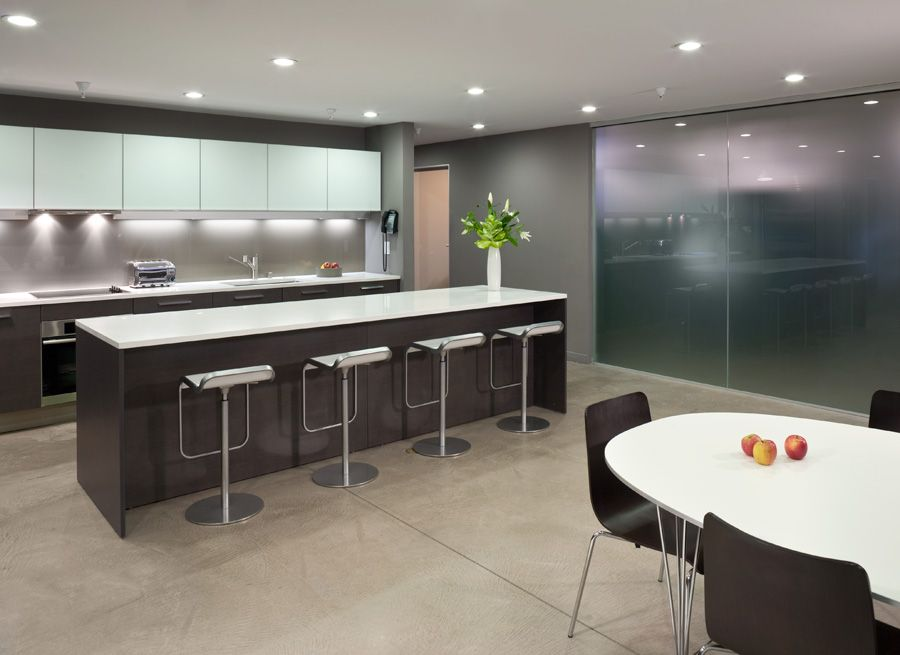 Contemporary Kitchen with wall oven, electric cooktop, can lights, Kitchen island, Corian counters, European Cabinets, Flush