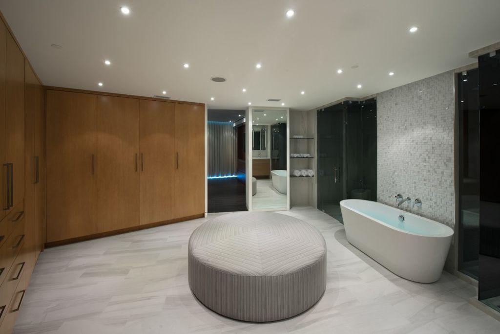Modern Master Bathroom with Flush, frameless showerdoor, can lights, Standard height, Wall Tiles, stone tile floors, Shower