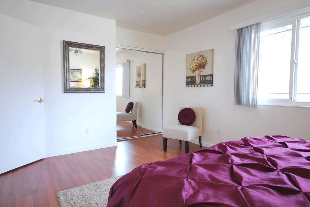 Eclectic Master Bedroom with Hardwood floors, flat door, Standard height, Casement
