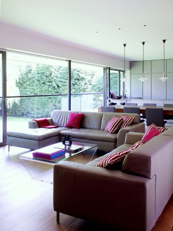 Contemporary Living Room with Columns, can lights, French doors, Hardwood floors, Standard height