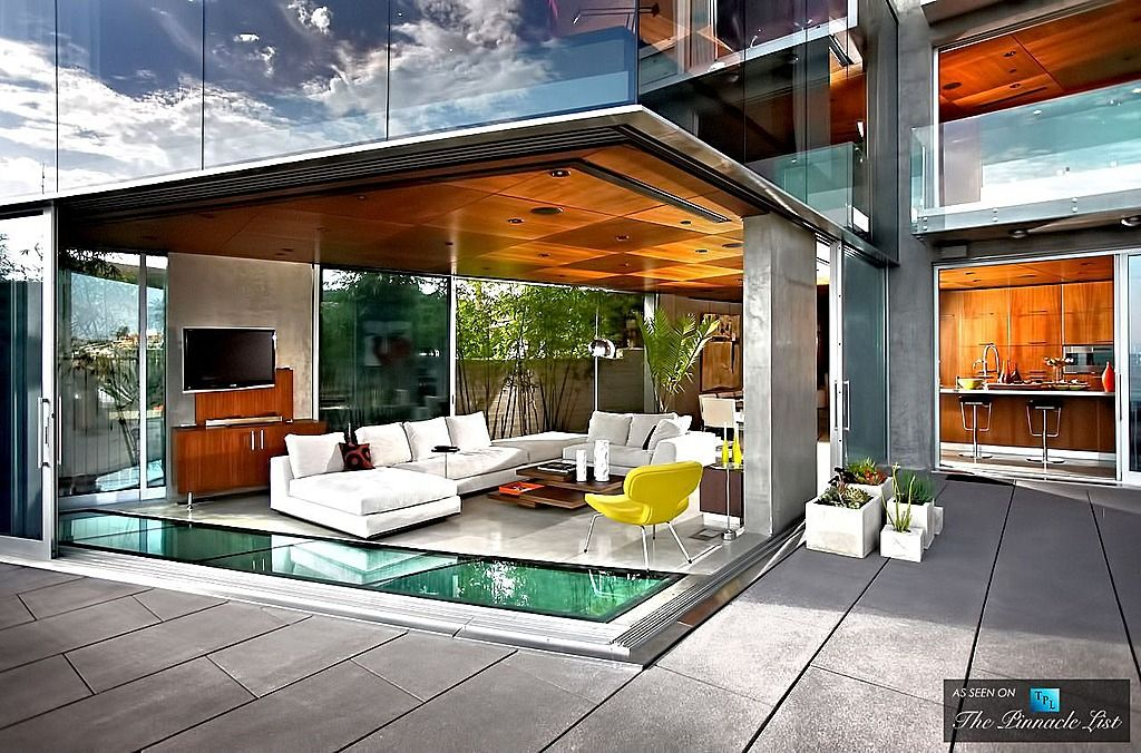 Contemporary Living Room with Standard height, Columns, Concrete tile , sliding glass door, Built-in bookshelf, can lights