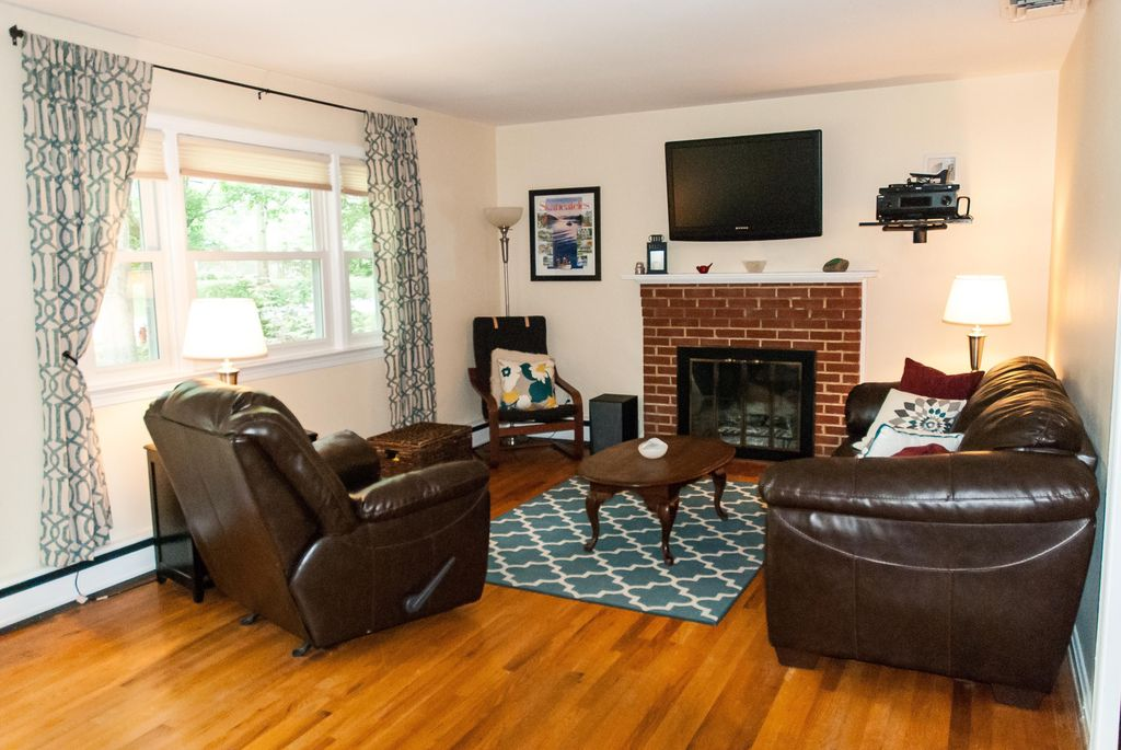 Traditional Living Room with double-hung window, Fireplace, brick fireplace, Standard height, Built-in bookshelf
