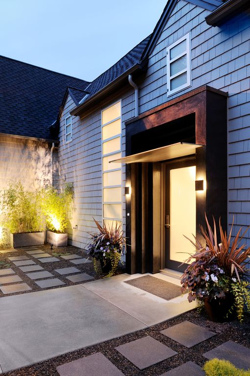 Contemporary Front Door with exterior concrete tile floors, Casement, French doors, Raised beds, exterior tile floors