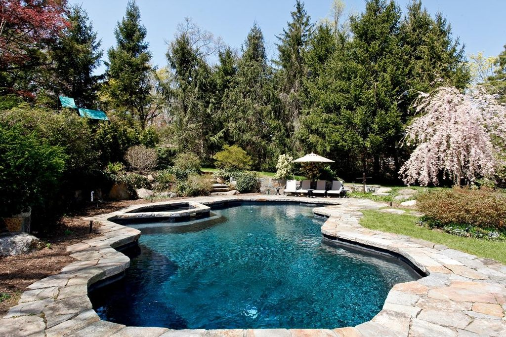 Rustic Swimming Pool with Pathway, Pool with hot tub, 20 in. and 21 in. irregular concrete tan variegated stepping stones