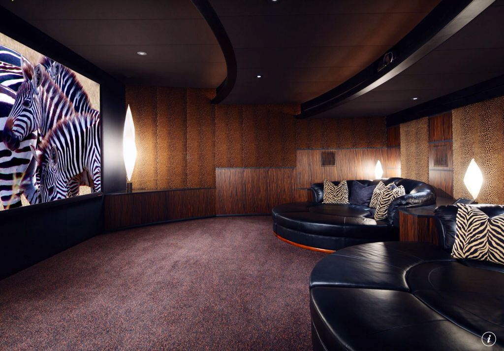 Eclectic Home Theater with can lights, Carpet, interior wallpaper, Standard height, Exposed beam