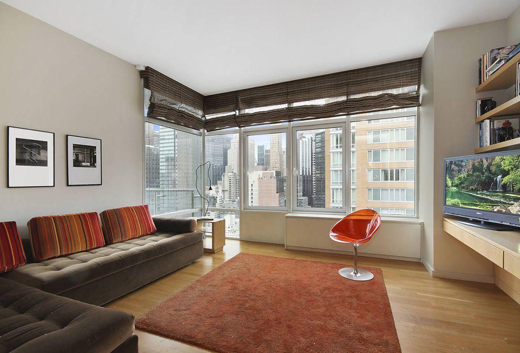 Contemporary Living Room with Casement, Hardwood floors, Standard height, Built-in bookshelf