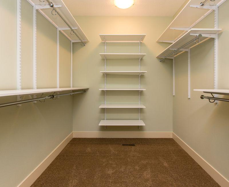 Traditional Closet with Built-in bookshelf, Carpet, Standard height, flush light