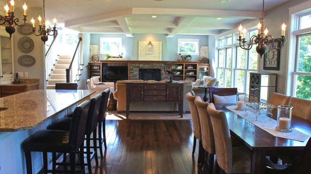 Traditional Great Room with Stair runner, Built-in bookshelf, Box ceiling, Carpet, Open concept, Hardwood floors, Chandelier