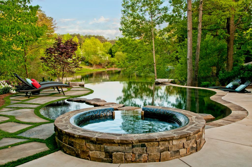 Rustic Swimming Pool with Fence, Pathway, Infinity pool, exterior stone floors