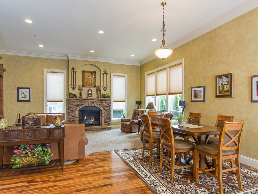 Traditional Great Room with Crown molding, Casement, can lights, Pendant light, Standard height, Hardwood floors, Fireplace