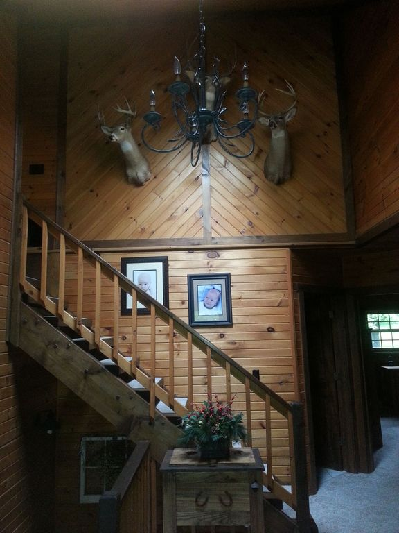 Rustic Staircase with High ceiling, Chandelier, Carpet, curved staircase