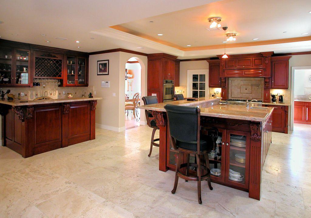 Traditional Kitchen with Pendant light, Standard height, Built-in bookshelf, stone tile floors, flush light, Crown molding