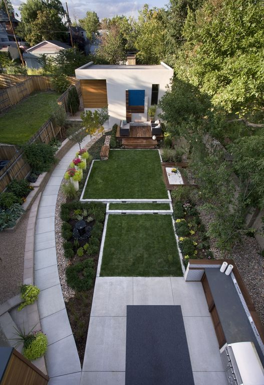 Contemporary Landscape/Yard with Gate, Outdoor kitchen, exterior concrete tile floors, exterior tile floors, Fence, Pathway