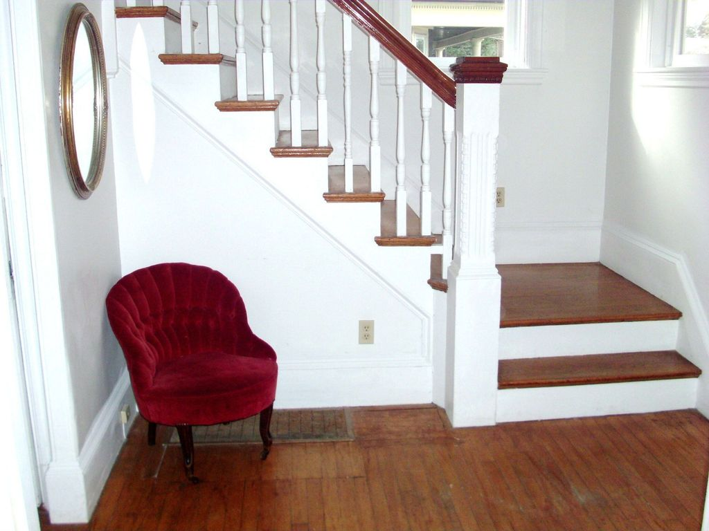 Traditional Staircase with picture window, curved staircase, High ceiling, Hardwood floors
