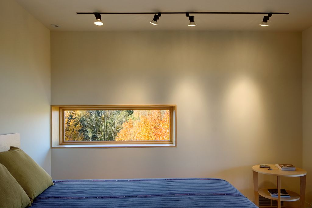 Contemporary Guest Bedroom with picture window, flush light, Standard height