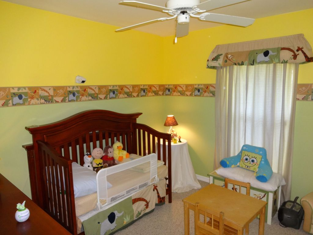 Eclectic Kids Bedroom with Standard height, Chair rail, Ceiling fan, no bedroom feature, Carpet