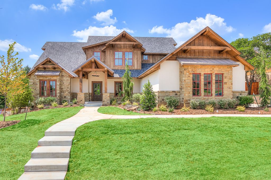 Rustic Exterior Of Home With Exterior Stone Floors Fence