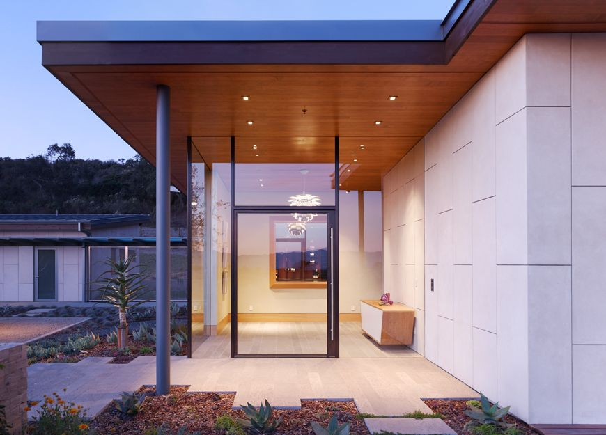 Contemporary Front Door with French doors, exterior tile floors