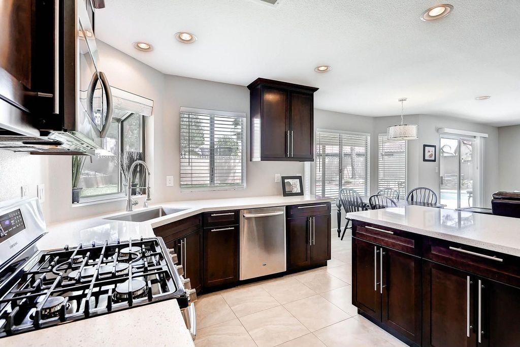 """Contemporary Kitchen with Flat panel cabinets, Breakfast nook, Dynasty Hardware European 15"""" Appliance Pull, L-shaped, Flush"""